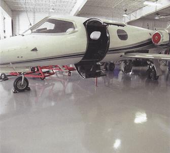 Polyaspartic floor coating in hangar - Sparta-Flex