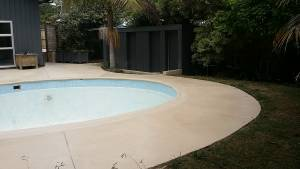 Resurfaced concrete around pool