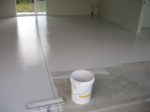 Applying a specialist epoxy paint to a garage floor.